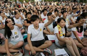 Student protesters crowding streets of Hong Kong, boycotting school and blocking city traffic