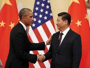 U.S. president Barack Obama and Chinese president Xi Jin Ping issuing a press release at APEC 2014 held in Beijing, China.